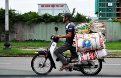 On its way (Roving I) Tags: transport loads bags motorcycles workers helmets street storks danang vietnam
