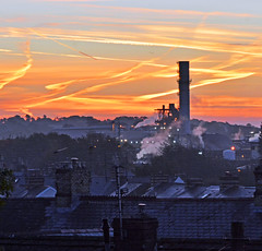 Dawn at Barry (robmcrorie) Tags: dawn barry wales dow corning red orange sky vapour trails rooftops welsh terrace slate