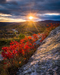 Mount Battie Sunset (BenjaminMWilliamson) Tags: autumn blueberry bushes camden colors fall foliage gifts granite hiking hills image landscape leaves light me maine mountbattie mountain nature newengland photography prints radiant rays raysoflight red rocky scenery scenic shrubs statepark sunbeams sunburst sunlight trail usa view
