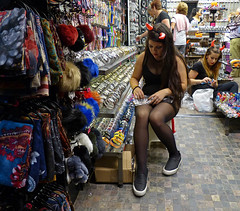 Satan's little helpers (Andy WXx2009) Tags: halloween stockings style street store people girls horns fancydress women candid streetphotography girl femme beauty legs benidorm shop brunette sexy devil sitting tights spain costablanca espana europe fashion horror cosplay costumes