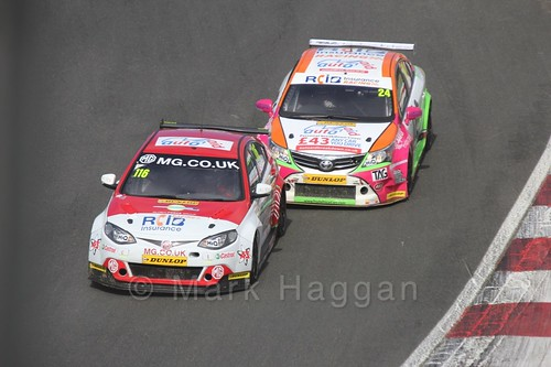 Jake Hill chases down Ashley Sutton during the BTCC Brands Hatch Finale Weekend October 2016