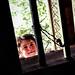 A girl looking down from the roof skylight, Karimabad, Pakistan パキスタン、カリマバード 天窓から部屋を見下ろす少女