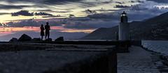Contemplating at sunset (Enrico Cusinatti) Tags: acqua clouds cielo canoneos6d camogli enricocusinatti faro italy italia liguria mare nuvole sea sunset sky travel tramonto