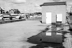 As Above, So Below (JamieHaugh) Tags: weymouth dorset blackandwhite blackwhite monochrome outdoor outdoors refection puddle building harbour boats sky