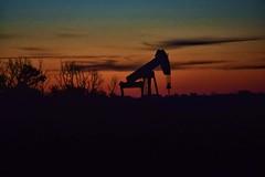 Oil well sunrise (slammerking) Tags: oil oilwell kansas sky sunrise dawn silhouette pumpingunit well petroleum