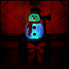 Choppity chop chop... (Creepella Gruesome) Tags: iphone6splus hipstamatic christmas holiday festive decorations frostythesnowman hatchet lights colors night evening squareformat spooky dark creepy phantasm