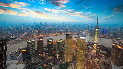 shanghai in sunset (DJANDYW.COM & DJANDYW.TV AKA ANDREW WILLARD) Tags: shanghai sunset dusk aerial view glow building skyline river modern city china architecture asia business center cityscape downtown financial landmark metropolitan scene skyscraper tower travel urban background chinese holiday corporate abstract commerce orient oriental pearl metropolis twilight horizon sky cloud beautiful destination journey attraction nightfall