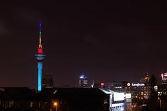 Sky-Tower Rainbow (Rogan Templer) Tags: newzealand night canon auckland slowshutter northisland skytower aucklandcity 600d