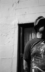 untitled (Stemack Street) Tags: street leica shadow blackandwhite man film face 35mm kodak candid yorkshire trix streetphotography 400tx whitby mysterious analogue m6 teeshirt