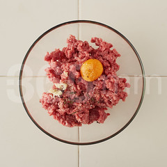 Ingredients for making meatballs on a bowl (365mm.cat) Tags: cooking glass ball recipe egg cook bowl meat garlic mixing overlook making meatballs overhead meatball preparing yolk overview ingredientsmixed