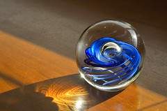 Glass can be useless but beautiful (herecomesanothersongaboutmexico) Tags: blue glass crystal swirl useless crystalball