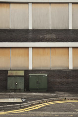 DSC_3138 [ps] - 1717 (Anyhoo) Tags: road street old uk england urban brown white brick green abandoned window tarmac yellow metal wall architecture facade concrete grid grey design wooden 60s rust closed purple flat bend cabinet box pavement timber decay empty board tan modernism structure surrey stained faded ash boardedup sheet 1960s streetfurniture straight curve asphalt kerb bt sweep sixties godalming faade plywood modernist doubleyellowlines linear roadmarkings shutdown catteshalllane layby anyhoo parkingbay godalmingpolicestation telephonecabinet photobyanyhoo