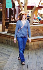 Scottsdale Old Town Shopping (Philip Osborne Photography) Tags: wood old arizona woman hat smiling walking town cowboy jeans deck flip flops scottsdale