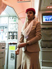 A flight attendant woman wearing beautiful costume in Emirates airline (inchiki tour) Tags: travel woman photo costume iran persia emirates airline silkroad