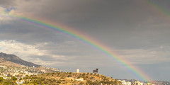 The Bull And A Rainbow (k009034) Tags: travel sky mountain building tower beautiful weather clouds canon landscape photography eos 350d rainbow spain scenery cloudy hill bull andalucia rebelxt fuengirola beautifulearth