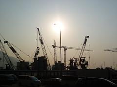 Harbour works (m_artijn) Tags: sunset hongkong harbour cranes