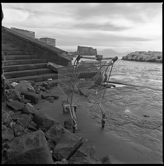 (Please Don't You Be Very Long) (Robbie McIntosh) Tags: blackandwhite bw 120 6x6 film monochrome mediumformat square landscape seaside ruins rocks carriage 10 decay shoreline shoppingcart cobblestones hasselblad negative ilfordhp5 shoppingtrolley hp5 ilford 400iso dyi casteldellovo pellicola hasselblad500cm selfdevelopment mittelformat moyenformat filmisnotdead acufine medioformato newtopography homedevelopment colonnaspezzata newtopographic carlzeissdistagon50mmf4ct
