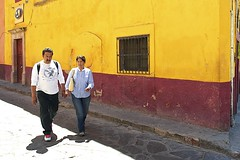 street love.. (camelot98.) Tags: road street leica city travel light red urban color colour love yellow walking mexico couple shadows bright candid streetphotography sunny mexican streetshot
