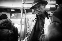 Newspapermanicus Extincticus - (wkmoore) Tags: urban blackandwhite chicago man hat subway newspaper cta reporter streetphotography busstop fedora blackandwhitephotography chicagosuntimes chicagoarchitecture newspaperman