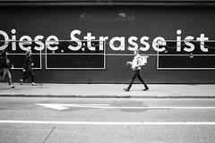 Diese Strasse ist (gato-gato-gato) Tags: 35mm asph ch iso400 ilford leica leicamp leicasummiluxm35mmf14 mp mechanicalperfection messsucher schweiz strasse street streetphotographer streetphotography streettogs suisse summilux svizzera switzerland wetzlar zueri zuerich zurigo zrich analog analogphotography aspherical believeinfilm black classic film filmisnotdead filmphotography flickr gatogatogato gatogatogatoch homedeveloped manual rangefinder streetphoto streetpic tobiasgaulkech white wwwgatogatogatoch zrich manualfocus manuellerfokus manualmode schwarz weiss bw blanco negro monochrom monochrome blanc noir strase onthestreets mensch person human pedestrian fussgnger fusgnger passant zurich