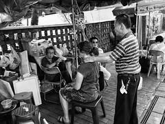 Neck massage . (-Faisal Aljunied-) Tags: faisalaljunied neckmassage streetphotography ricohgr streetlife singapore