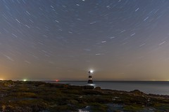 700 seconds of Lighthouse (Graham Peers) Tags: lighthouse long exposure nightscape landscape star trail stars water rock nikon d600 tokina 2470 28 north wales penmon seaweed colour outdoor sky beach startrails ngc
