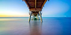 Beneath the pier (Lee Roach - Fenix Blue) Tags: pier sunset queensland wooden longexposure nisi filter infinity australia tourism ocean sea water