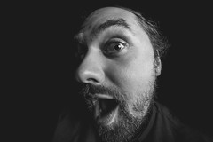 was geschiiieht? (Zesk MF) Tags: 8mm portrait nikon d5500 sigma man beard verformt close black white person studio face expression fun
