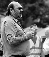 NHS or Not ? (Neil. Moralee) Tags: middevoncountyshowtivertonneilmoralee neilmoralee nhs national health service obese over weight overweight smoke smokers vale york clinical commissioning group man mature drink cider devon show county discrimination rites rights expensive fear unfair balding big glasses black white bw mono monochrome blackandwhite people outdoor candid beard neil moralee nikon d7100 18300mm zoom budget cuts savings wasted waste