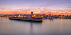 Ramsgate Sunset (dattenphotos) Tags: longexposure blue sunset sky orange sun lighthouse beautiful wall clouds boats lights coast kent sailing unitedkingdom harbour scenic seafront hdr sunray ramsgate ramsgateharbour
