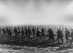 WWI0079B1 (ww1images) Tags: road panorama canada march track boots rifle helmet pack british column advance troops waterbottle spade allied messtin puttee