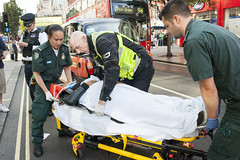 The crew work with a motorcycle responder to attend a patient who has been involved in a road traffic collision (London Ambulance Service) Tags: las accident ambulance crew nhs emergency paramedic brixton ae londonambulanceservice