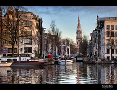 Amsterdam Canal (esslingerphoto.com (back in London)) Tags: city morning bridge trees reflection building church water netherlands amsterdam architecture sunrise canon buildings boats boat canal europe exposure cityscape architectural 5d drawbridge esslinger esslingerphotocom esslingerphoto vision:text=0536 vision:outdoor=0979 vision:street=071