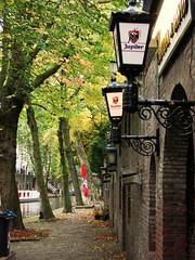 Along the Oudegracht (indigo_jones) Tags: autumn trees holland netherlands canal bomen utrecht nederland restaurants arches wharf lamps kelder oudegracht lampen werf