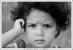 Portrait of a Child - Portrait d'enfant (Rachid Naim) Tags: africa old city portrait white black girl face canon eos eyes noir child hand dress robe main yeux morocco maroc medina casablanca safi et fille blanc brune ville vieux visage vieille afrique kasbah eljadida denfant azemmour