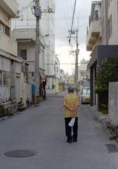 上地 歩くひと Okinawa-si, Okinawa (ymtrx79g ( Activity stop)) Tags: street color slr film japan analog nikon kodak 35mmfilm okinawa 135 沖縄 街 写真 銀塩 フィルム nikonnewfm2 沖縄市 kodakultramax400 nikonainikkor50mmf14 歩行走行 walkandrun 201310blog okinawasi