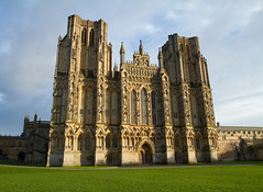 Wells Cathedral West Front (Mukumbura) Tags: uk blue winter england sky green history church grass sunshine architecture worship cathedral unitedkingdom religion wells somerset anglican welcomeuk