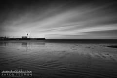 Look Right Through (Aaron Yeoman) Tags: uk longexposure greatbritain travel sea england sky urban blackandwhite bw cloud lighthouse motion reflection building art beach wet water lines architecture clouds reflections coast pier blackwhite seaside movement sand europe unitedkingdom ripple yorkshire horizon line northsea slowshutter gb coastline scarborough ripples lowtide southbay vignetting vignette northyorkshire a99 nd110 scarboroughlighthouse vincentpier minoltaaf1735mmf284d lee09ndgrad leebigstopper silverefexpro2 lee09ndproglass sonya99 slta99 sonyslta99 sonyalphaslta99