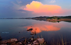 Another day... (Aadilsphotography) Tags: pakistan sunset orange reflection water clouds canon photography rocks dam studios rawal aadils fadils