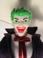 The Joker Mego Style 5924 (Brechtbug) Tags: show shadow bird television laughing dark comics toy toys book newspaper dc tv comic shadows purple action five cigarette character clown release sunday formal funnies prince super simpsons 66 wear adventure plastic suit crime national hero figure batman 70s joker knight 1970s villain section mattel villains harlequin holder publication mego the 2014 periodical