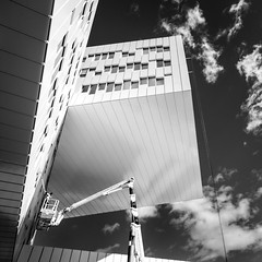 (Svein Nordrum) Tags: windows sky blackandwhite bw white black building clouds square crane perspective cleaning explore