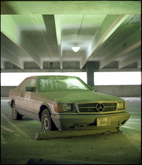 Abandoned Mercedes (Horo), Irving Blvd., Downtown, Dallas, Texas. Winter, 2014. =-=-=-=-=-=-=-=-=-=-=-=-=-= There's this Mercedes that's been sitting alone on one of the upper levels of the parking garage at work. Though I've been with this company some y (JunPx) Tags: urban 120 film field landscape photography mercedes pentax kodak garage parking plate ishootfilm license medium format 6x7 portra depth 120mm 160 abaondoned ibelieveinfilm wwwjuanpulidocom