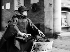 . (alb.montagna) Tags: street streetphotography streetportrait streetportraiture panning people blackandwhite monochrome zuiko olympus italy rain