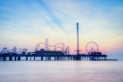 Pier-Sunrise-vii (Ray Devlin) Tags: texas lonestarstate gulfofmexico coastaltexas coastal usa america shoreline sea galvestonisland galveston historic pleasure pier galvestonhistoricpleasurepier seaside jetty fairground rides bigwheel silhouette sunrise beach long exposure seawall light trails