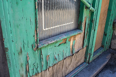 Colorful old weathered door (Mila Araujo @Milaspage) Tags: retro dreamstime istock door green turquoise blue old maintence refinishing deterioration time fallingapart paint chipping weathering weathered wood waterdamaged damaged peeling plywood