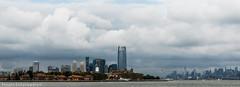 cloudy (hosam alshanawany) Tags: libertyisland nikon nikkor nyc newyork ny newyorkcity new manhattan ellisisland lr lightroom life clouds city ocean colors skyline sky s