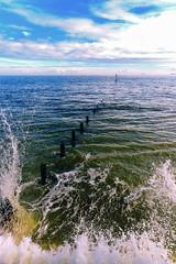 Splash in Multi-Colour (Simon Downham) Tags: sea wave waves breaker breakers sky cloud light foam splash water seaside wind dsc5142