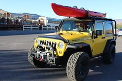 Florida Keys Jeep with kayak on roof and fashion doll on hood (EllenJo) Tags: jeep itsajeepthing yellowjeep monroecountyfloridaplates redkayak barbiedoll fashiondoll hoodornament wacky verdecanyonrailroaddepot clarkdale arizona az october20 2016 ellenjo