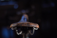 Original Is Best (cathbooton) Tags: bokeh canoneos canon6d ef50mm saddle leather cracked worn bike bicycle indoor light november afternoon vintage abstract