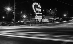 Morse & High (tim.perdue) Tags: more road high street rd st corner intersection norht columbus ohio beechwold clintonnville black white bw monochrome monovember 2016 monovember2016 night dark long exposure traffic lights streetlight neon sign arrow teejayes light trails